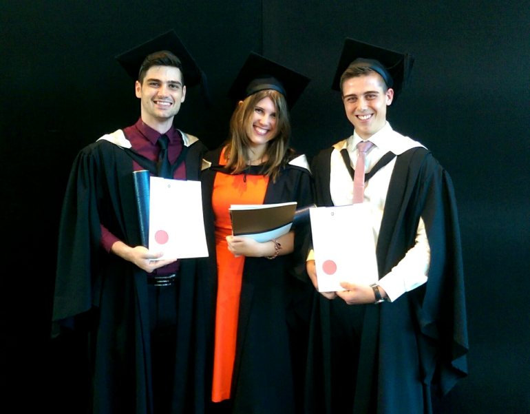 Jake with his friends Laura and Johann at their graduation